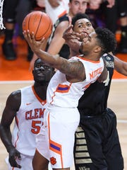 Clemson guard Shelton Mitchell (4) drives to the basket past Wake Forest center Doral Moore (4) during the 1st half on Tuesday, February 14,  2017 at Clemson's Littlejohn Coliseum.