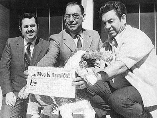 Camarillo Rotarians Bob Hernandez (left), Chuck Welch and Mike Loza hold a blowup of the original Viva La Comida ticket — prices $2 for adults and $1 for children. The photo was taken for the Camarillo Daily News to publicize the first Viva dinner in 1971. The event is still held, with the next one scheduled for Tuesday.