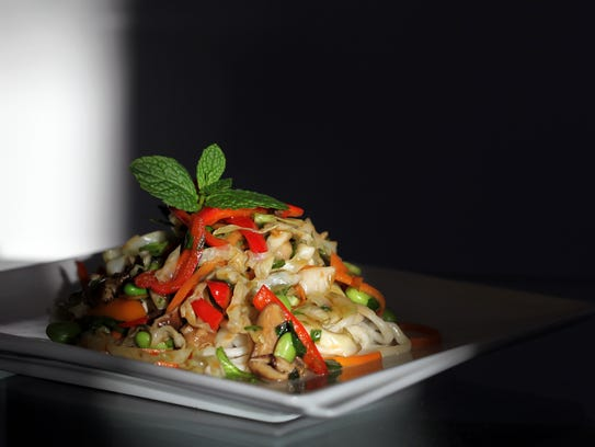 Stir-fry vegetable salad with Asian dressing.