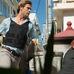 """This photo provided by Universal Pictures shows Chris Hemsworth, left, as Nicholas Hathaway in Legendary's """"Blackhat,"""" from director/producer Michael Mann.  (AP Photo/Legendary Pictures - Universal Pictures, Frank Connor)"""