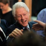 Former President Bill Clinton greets people in the audience after speaking in support of his wife, Democratic presidential candidate Hillary Clinton, Thursday, April 14, 2016, at the Community College of Rhode Island, in Warwick, R.I. (AP Photo/Steven Senne)