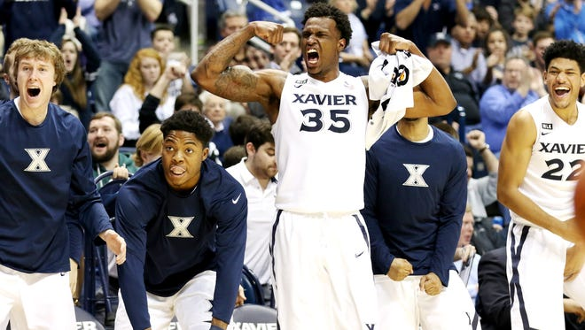 The Xavier bench cheers as teammate Edmond Sumner ties the game at 66 with Creighton in the second half at the Cintas Center Monday, January 16, 2017. The No. 22 Musketeers (13-5) lost to seventh-ranked Creighton, 72-67.