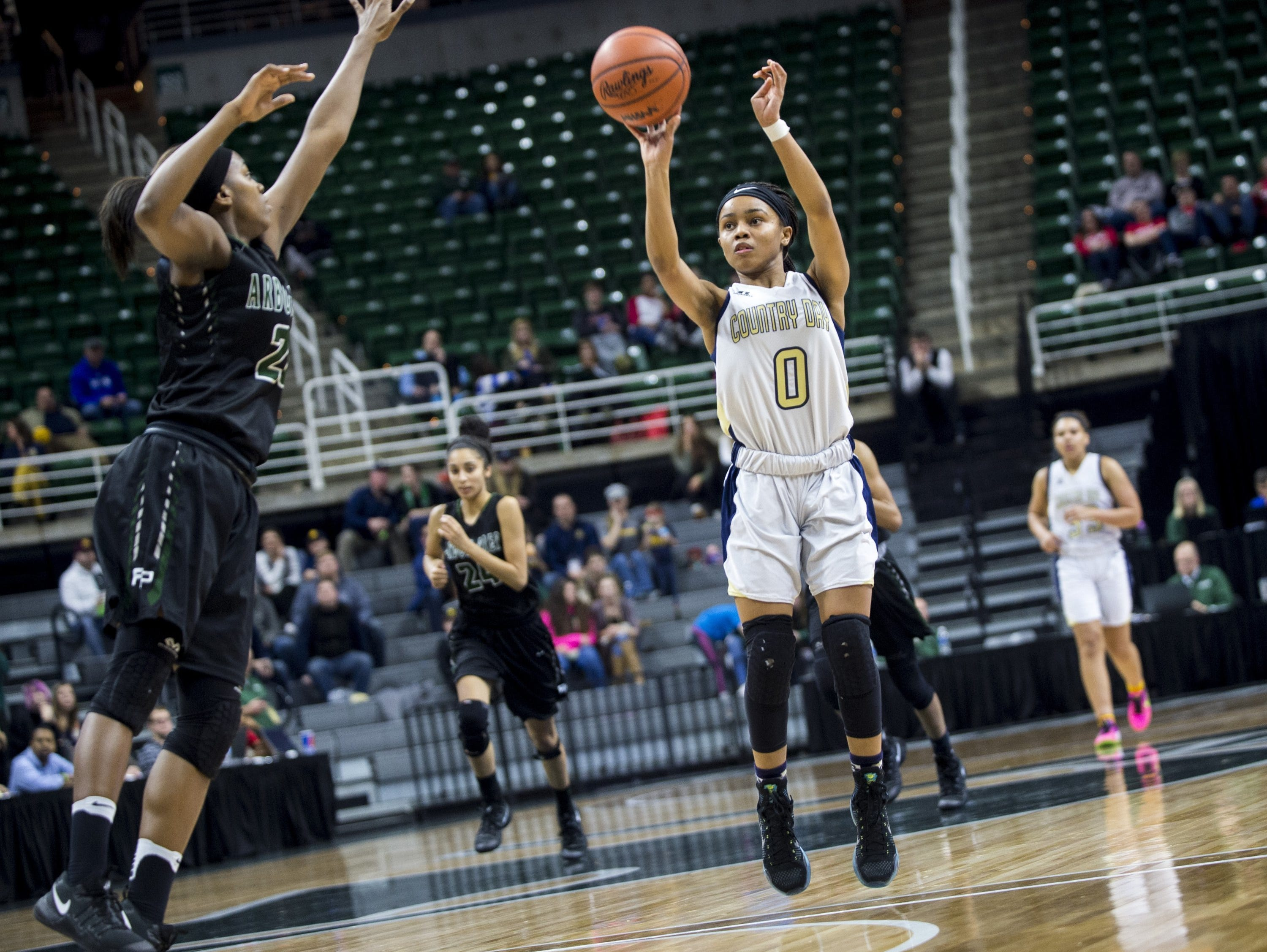 Birmingham Detroit Country Day's Kaela Webb shoots over an Ypsilanti Arbor Prep defender during the Class B state title game March 18, 2017, in East Lansing.
