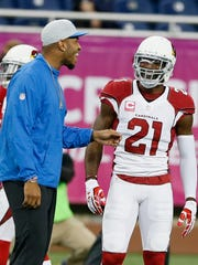 Cardinals CB Patrick Peterson talks with Lions TE Eric Ebron on Oct. 11, 2015, in Detroit.
