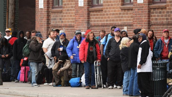 Homeless people line to get in for the night at Denver Rescue Mission.