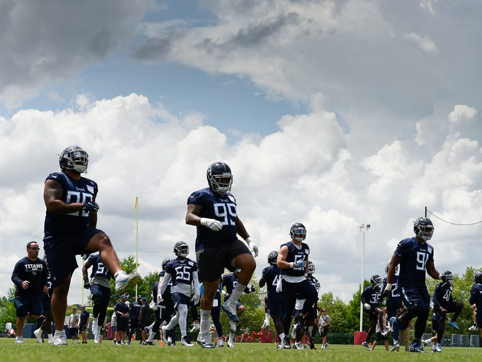 The Tennessee Titans warm up before their practice