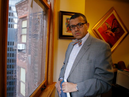 Moises Hernandez looks outside from his office on Thursday, Nov. 17, 2016, in Chicago. Moises Hernandez, a longtime Chicago immigration attorney, said he's seen an uptick in inquiries from clients since the election. He said many of the questions are from young people living in the country illegally who were granted work permits under a federal program started by President Barack Obama's administration. He said he's also heard from those with green cards who want to become U.S. citizens.