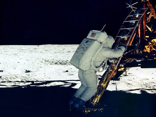 Astronauts Neil Armstrong and Buzz Aldrin landed on the moon at 4:18 p.m. Eastern time on July 20, 1969. Astronaut Buzz Aldrin descends the ladder from the Lunar Module in this photo.