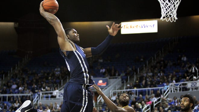 Wolf Pack forward Cameron Oliver goes in for a dunk against UC Irvine.