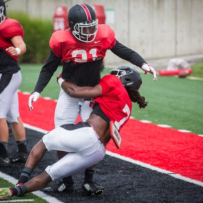 Ball State's Aaron Taylor (7) and Romero Wade work