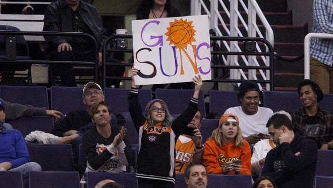 Suns fans cheer their team on against the Philadelphia 76ers in the second half at Talking Stick Resort Arena in Phoenix on Friday, Dec. 23, 2016.