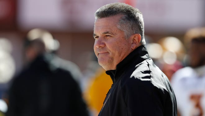 Oct 21, 2017; Salt Lake City, UT, USA; Arizona State Sun Devils head coach Todd Graham keeps an eye on the action in the first quarter against the Utah Utes at Rice-Eccles Stadium. Mandatory Credit: Jeff Swinger-USA TODAY Sports