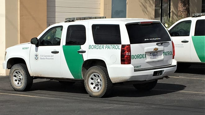Border Patrol trucks parked during a search of a storm drain Wednesday morning behind the Angry Owl restaurant on North Mesa Street.