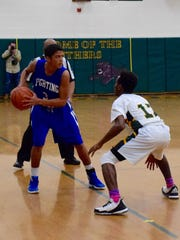 Robert E. Lee's Jayden Williams is guarded by Bruton's