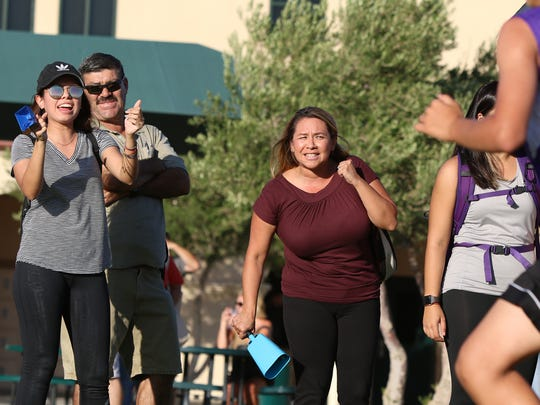 Ericka Serrato, left, and Enedina Diener cheer during the first DVL cross country meet held at Xavier Prep High School in Palm Desert on Wednesday, September 20, 2017.