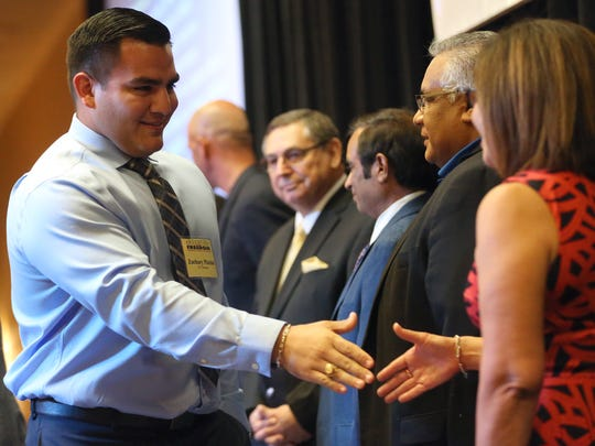 Zachary Pizzini shakes hands with sponsors during the Education Is Our Freedom GED College Scholarship Banquet on Tuesday, July 25, 2017, in Corpus Christi.