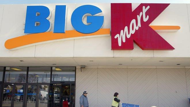 Shoppers depart a Big K Kmart store.