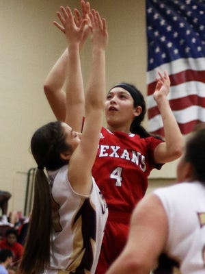 Ray's Brittany Colunga (4) shoots over Tuloso-Midway's Emily Cortez (21) during their District 30-5A North Zone Game in Bobby Craig Gymnasium on Tuesday, January 21, 2017.