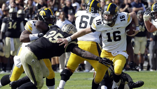 Purdue linebacker Ja'Whaun Bentley goes after Iowa quarterback C.J. Beathard in last month's game.