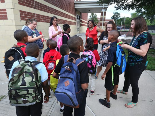 In a 2015 photo, students arrive for the first day of school at Indianapolis Public School 44. In 2016, the district approved converting the school to an innovation network school.
