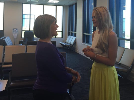 Lynn Copeland (left) talks to April Nelson at Monroe