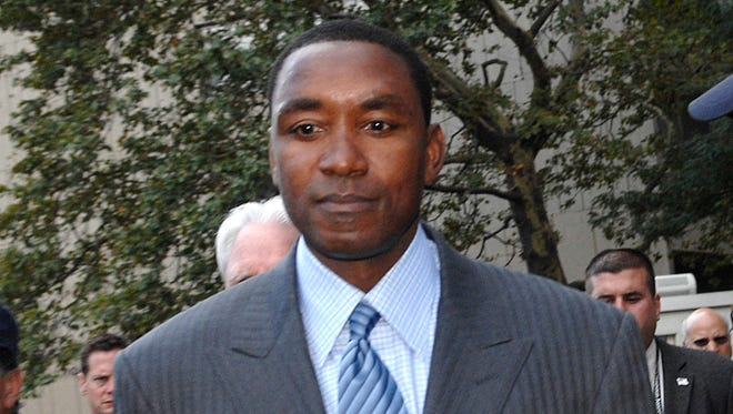 In this Oct. 2, 2007, file photo, then-New York Knicks President and coach Isiah Thomas exits Manhattan federal court following the jury decision in the sexual harassment lawsuit against him and Madison Square Garden in New York.