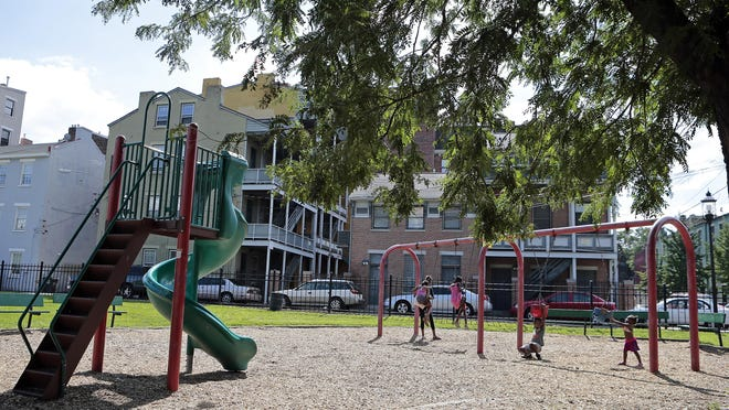 Children play on the swings at Ziegler Park last July.