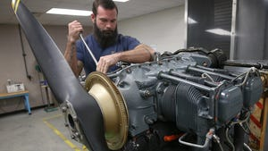 Aviation Power Plant student Ryan Williams removes spark plugs from a Lycoming aircraft engine on Wednesday at Tom P. Haney Technical Center.