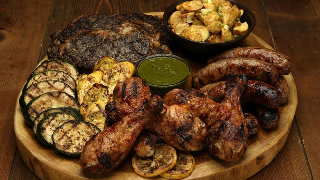 Your mixed grill can be nearly endless combinations of meats, sausages and vegetables. Don't forget to offer some simple side dishes, such as potato salad.