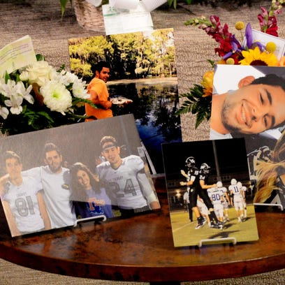 Pictures on display at the memorial service for ULM