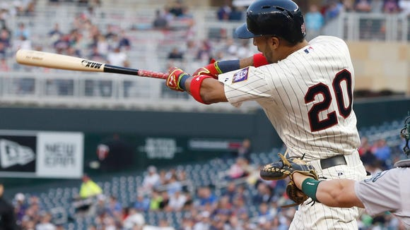 Minnesota Twins' Eddie Rosario hits his first major league home run on the first pitch off Oakland Athletics pitcher Scott Kazmir in the third inning of a baseball game, Wednesday, May 6, 2015, in Minneapolis. (AP Photo/Jim Mone) ORG XMIT: MNJM103