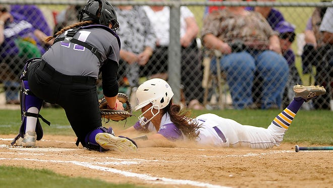Hardin-Simmons catcher Lauren Williams (11) tags out Mary Hardin-Baylor baserunner Myranda Hinojosa (1) trying to score during the top of the fourth inning of the Cowgirls' 8-2 loss to Mary Hardin-Baylor on Friday, April 14, 2017, at HSU's Ellis Field.