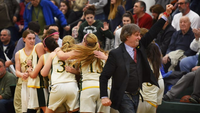 Pascack Valley head coach Jeff Jasper celebrates his team's victory 70 to 42 against NV/Old Tappan as the players hug each other in the second half of the North 1, Group 3 championship game at Pascack Valley High in Hillsdale on March 7th, 2017.