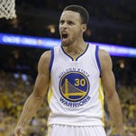 Golden State Warriors guard Stephen Curry (30) reacts after Shaun Livingston scored against the Oklahoma City Thunder during the second half of Game 7 of the NBA's Western Conference finals in Oakland, Calif. The defending champion Warriors won 96-88 on Monday, May 30, 2016.