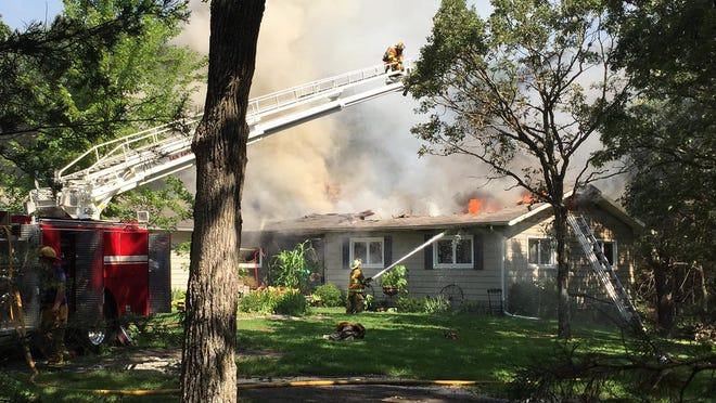 Three fire departments were called to a house fire on 60th Street Southeast in Sherburne County on Friday morning.