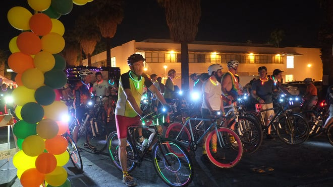 """Riders and vendors take part in the """"Cycledelic"""" bike festival in downtown Palm Springs, Thursday, October 16, 2014. A spinning class, bike rentals, and a twilight ride were all part of the event held in conjunction with the Street Fest.Riders wait for the start of the """"twilight"""" ride along Balardo."""