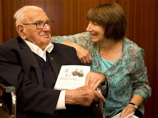 Nicholas Winton shares a moment with his daughter,