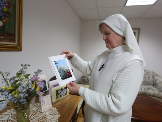 Sr. Mary Aimee with a photo she took, printed on a
