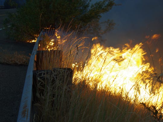 Fire burns near a bridge at Pollard Flat about 35 miles