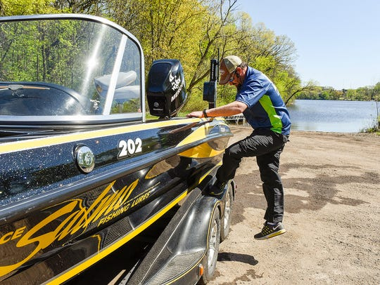 Fishing guide Doug Hanson packs his boat after making