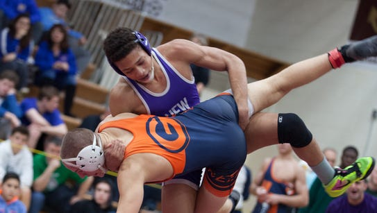 Jordan Wallace of New Rochelle faces off against Jacob