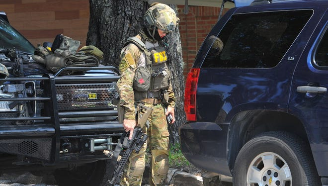 A member of the FBI SWAT team after searching the Pulse nightclub Sunday in Orlando.