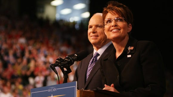 Sen. John McCain stands with then-Alaska Gov. Sarah Palin onstage at a campaign rally August 29, 2008 in Dayton, Ohio. McCain announced Palin as his vice presidential running mate at the rally.