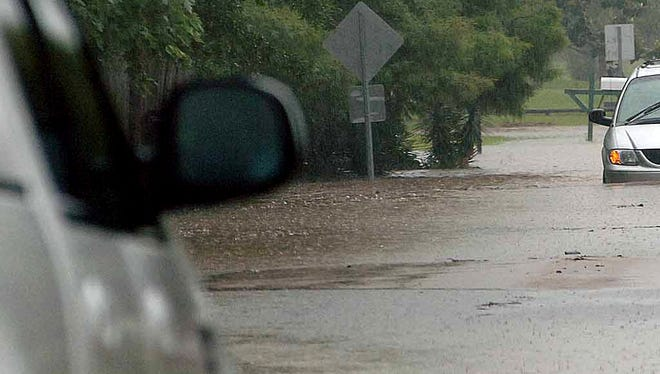 A driver looks ahead while driving through flash flood waters in Mississippi in this 2008 photo.