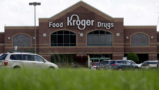 A Kroger store is shown Tuesday, June 17, 2014, in Houston. (AP Photo/David J. Phillip) ORG XMIT: TXDP101