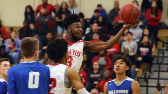 Hamilton's Chris Green (3) drives to the basket against