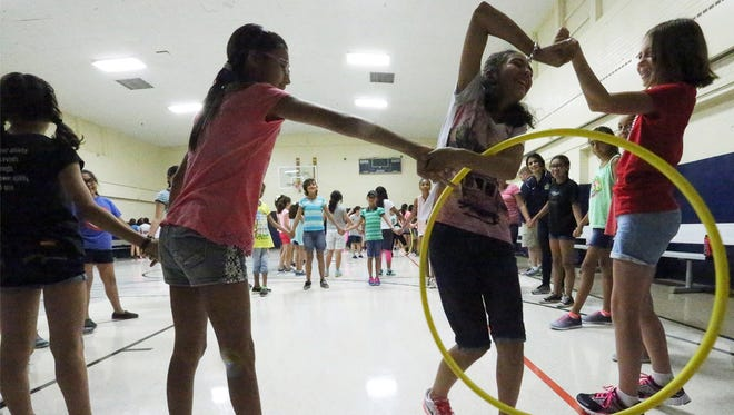 Students enrolled in the new Young Women's Leadership Academy work their way through a hula hoop while holding hands Wednesday at the new girls-only academy at 7615 Yuma Drive. More than 200 sixth- and seventh-graders from throughout El Paso are taking part in a summer camp and will start their first year at the academy Aug. 22.