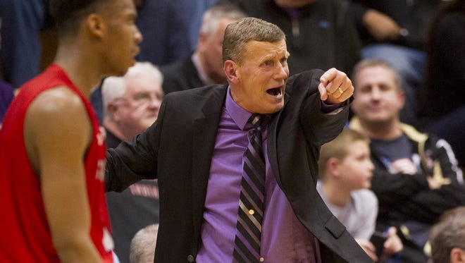 Ben Davis High School head coach Mark James reacts to the action on the court during the second half of action. Perry Meridian High School hosted a IHSAA Boy's Basketball 4A Sectional semi-final game, Friday, March 6, 2015. Southport won 45-27.