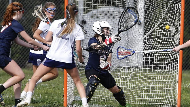 Janie Cowley scores of  Manasquan scores against Brenna Arey (8) of Wall Twp. during  SCT girls lacrosse game at  Sea Girt  Army Camp, Seagirt,NJ.  Wednesday, May 11, 2016.  Noah K. Murray-Correspondent/Asbury Park Press