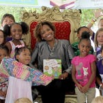 Jackie Parker, director of global philanthropy and corporate giving at General Motors, reads to Detroit students on July 28, 2016 for Reading and Rhythm on the Riverfront. The program, managed by the Detroit Riverfront Conservancy and funded in part by the GM Foundation, offers weekly events to keep kids engaged and inspired to learn during the summer months.